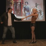 Cast member for the student presented play of The Rocky Horror Picture show on stage dancing with one of the female protagonists of the play.