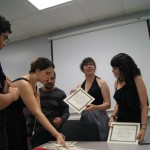 Students being handed their member certifications at the EDSA Fall Initiation of 2014.