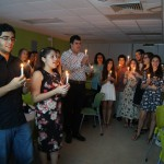 Students holding lit candles at the EDSA Fall Initiation of 2014.