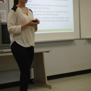 A student presenting material in front of the classroom at the Linguistics Colloquium 2015.