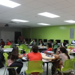 A room full of participants listening to a presentation during the Banned Book Week with EDSA.