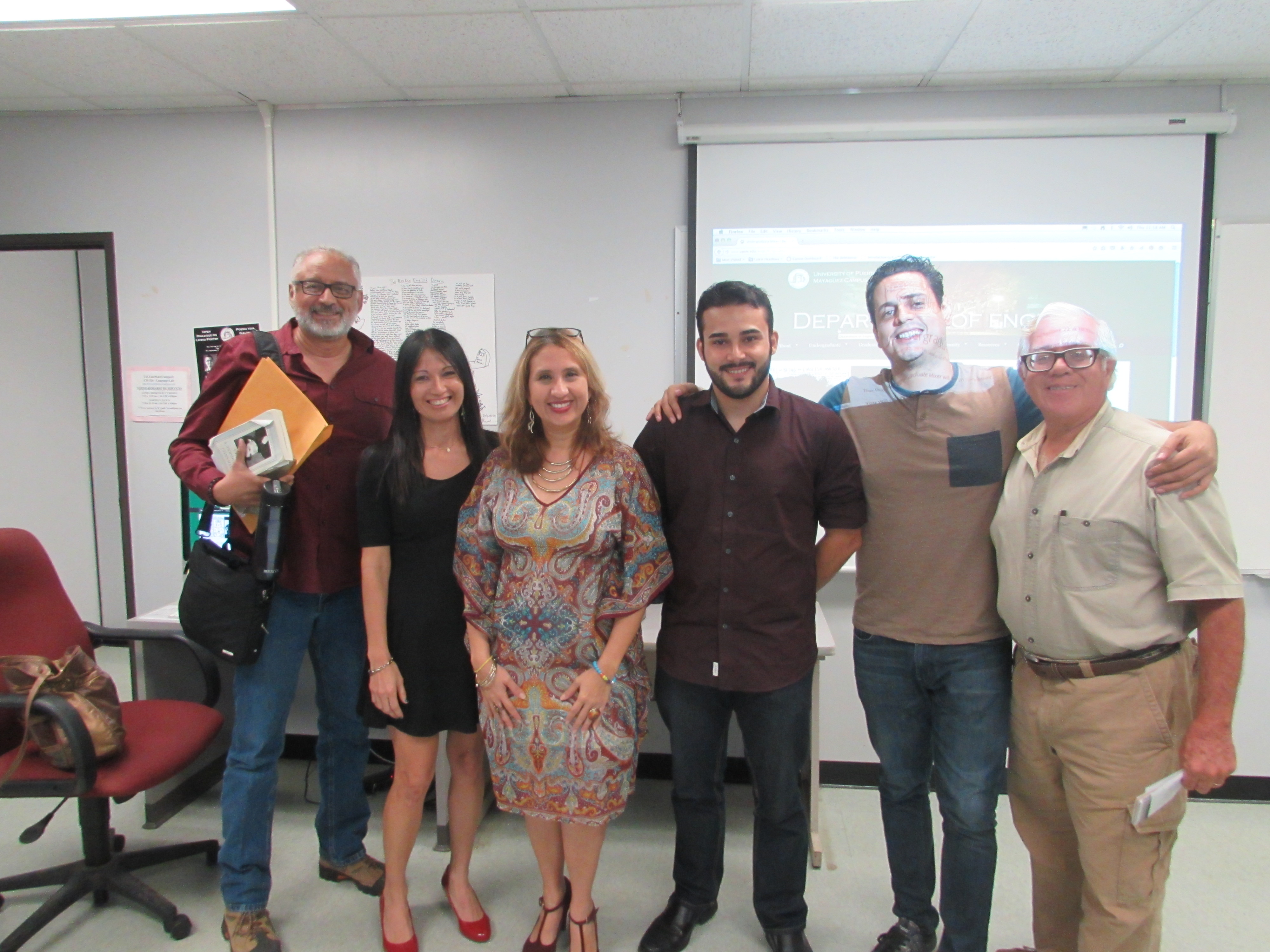 Faculty Advisors and well known college professors of the English Department posing for the camera.