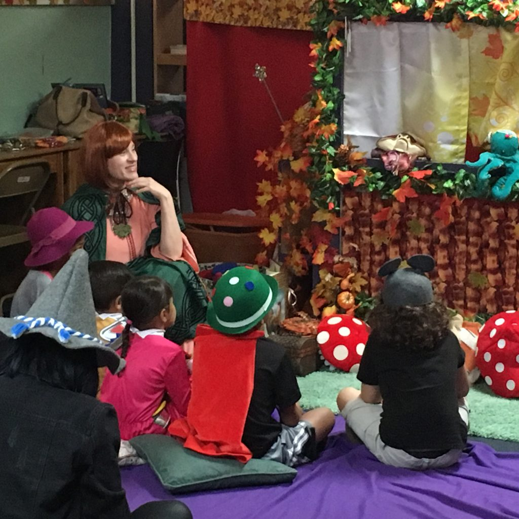 A member in costume is interacting with the children at the Children's Library Puppet Show.