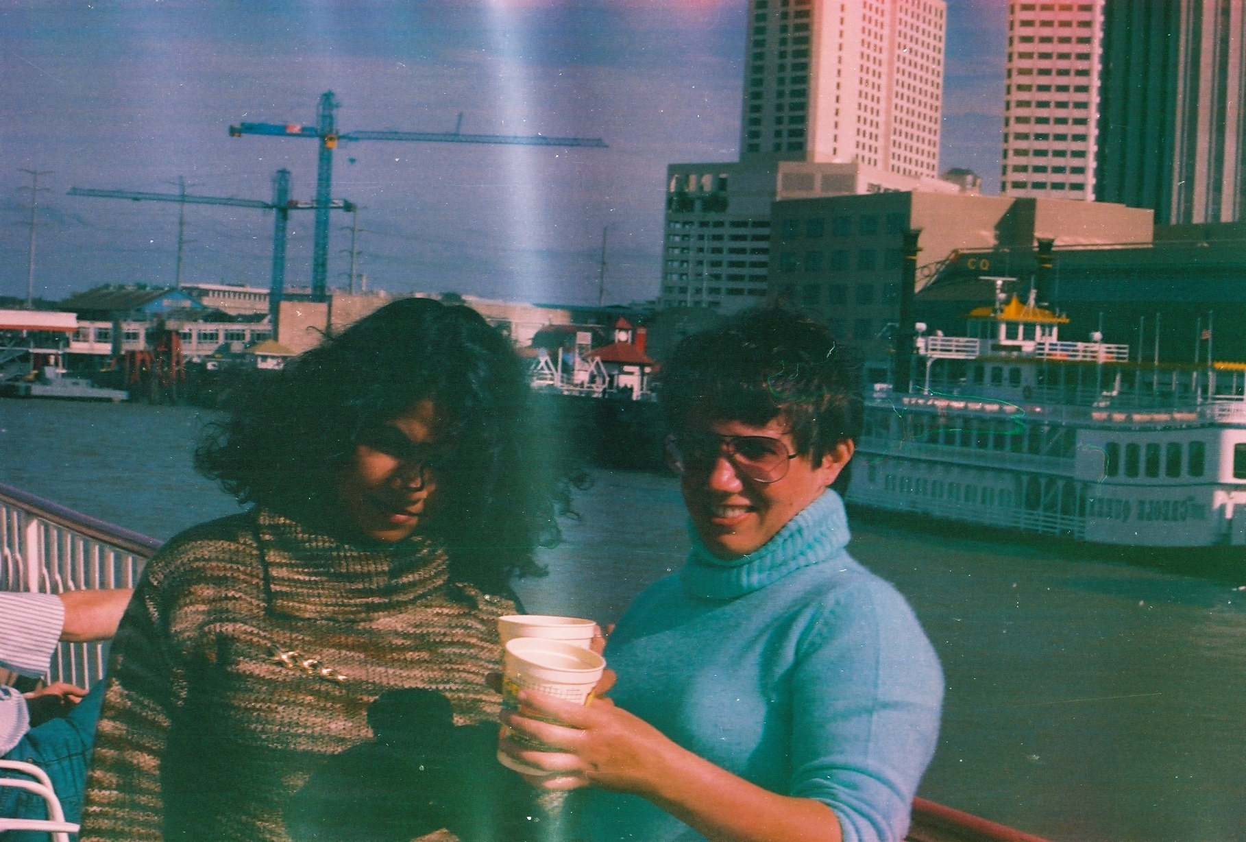 Liz Dayton with a girl friend with a drink, after MLA conference in New Orleans in 1988.