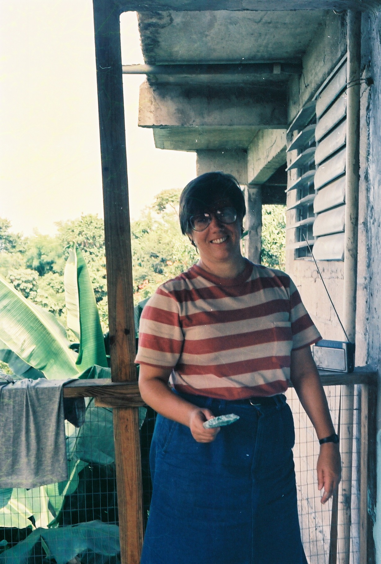 Young Liz Dayton painting her apartment.