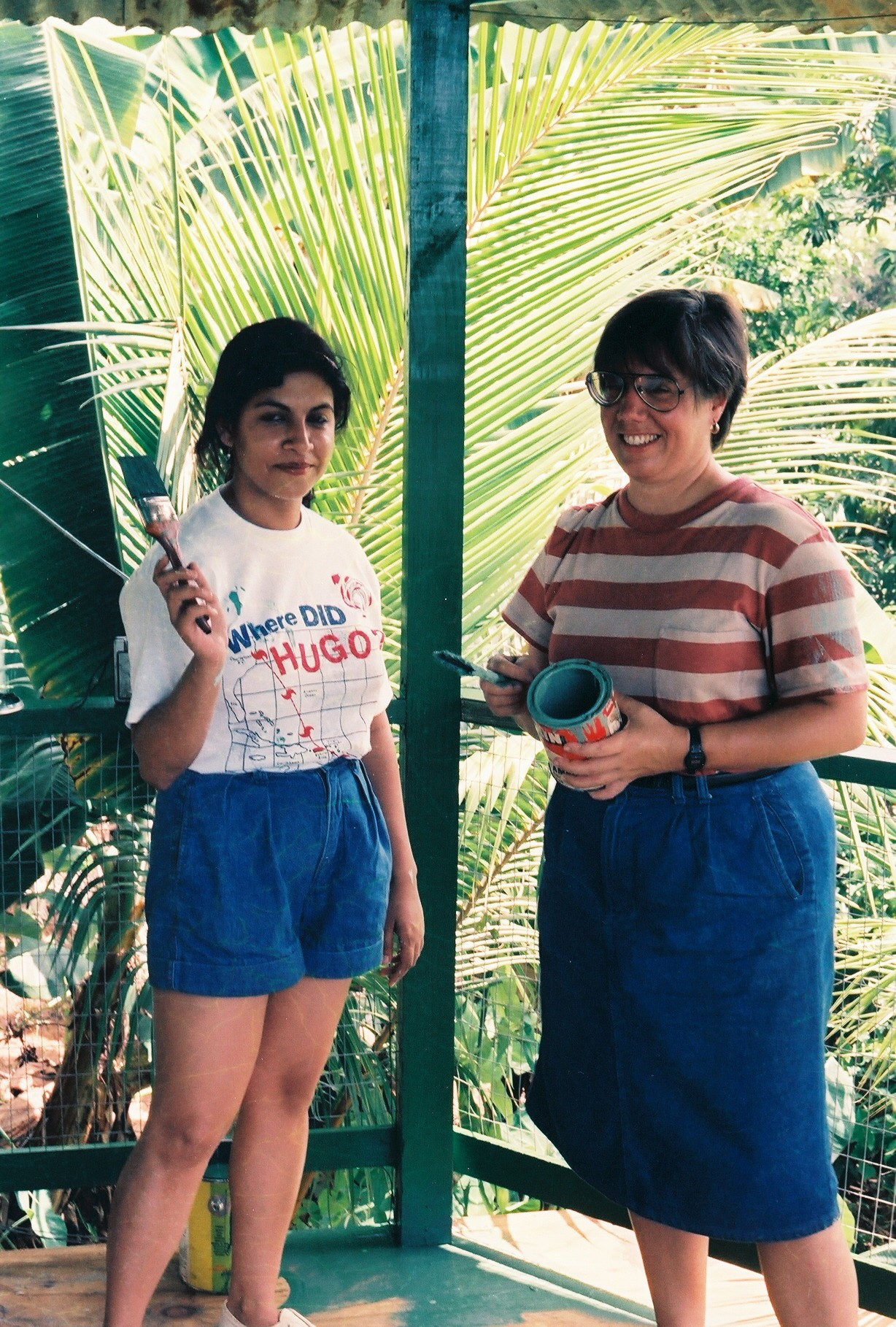 Young Liz Dayton with another girl, painting her apartment, probably after Hurricane Hugo.