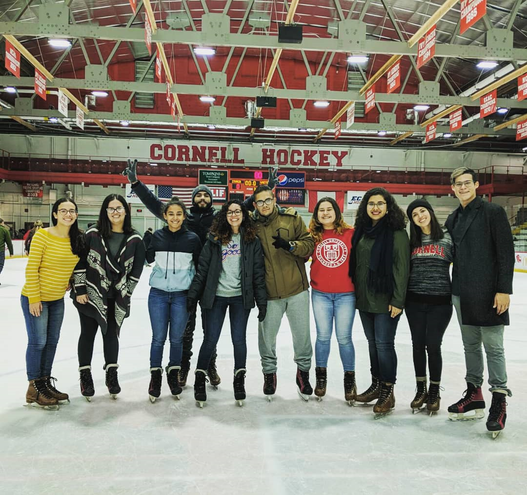 A group of students standing at the Cornell Hockey Rink