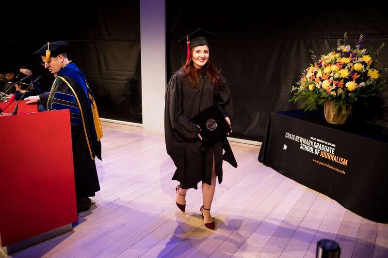 Photo of Claudia Irizarry receiving diploma.