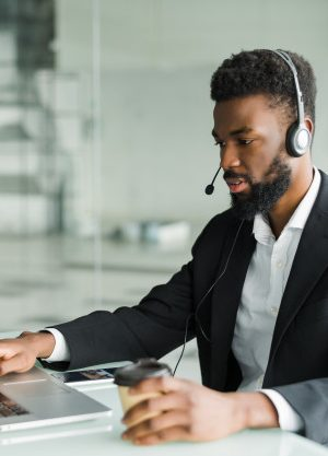 african-american-man-customer-support-operator-with-hands-free-headset-working-office_231208-686