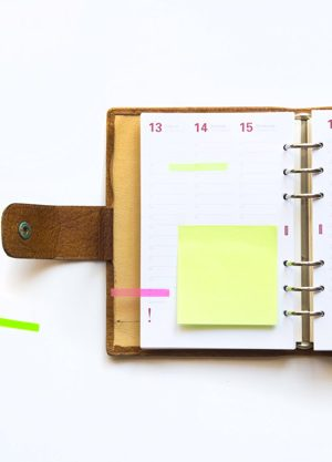 agenda-with-colorful-post-it-reminders_136346-3046